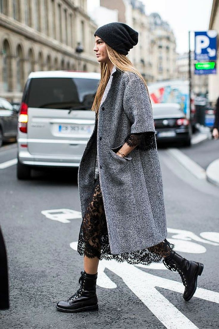 sneakers and pearls, street style, grey coat over a  black lace dress worn with military boots and a beanie, trending now.jpg