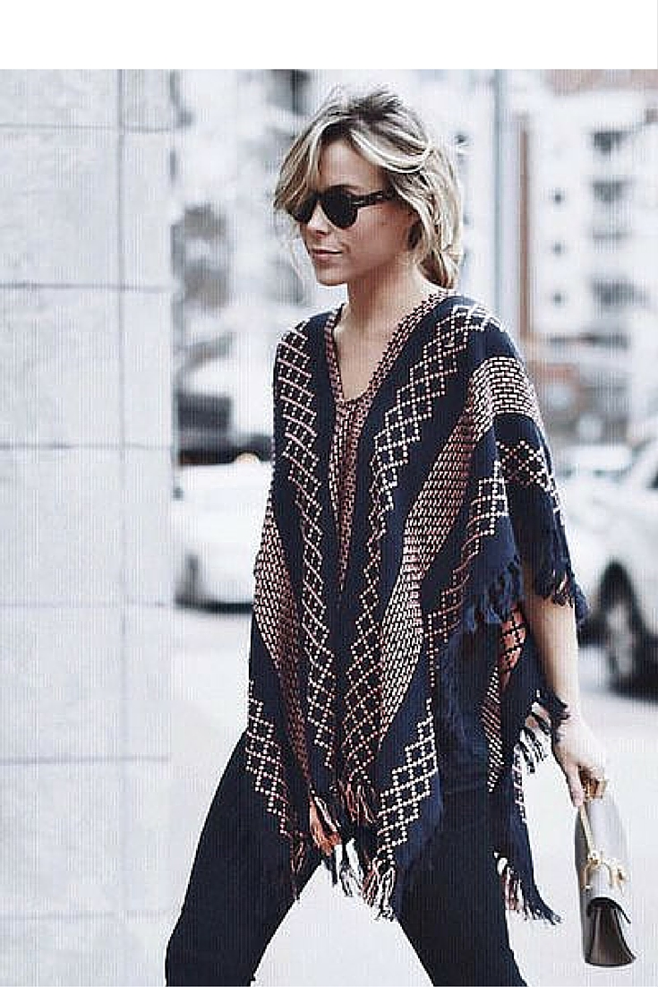 sneakers and pearls, street style, bohemian style with a poncho and wide leg black pants, trending now.jpg