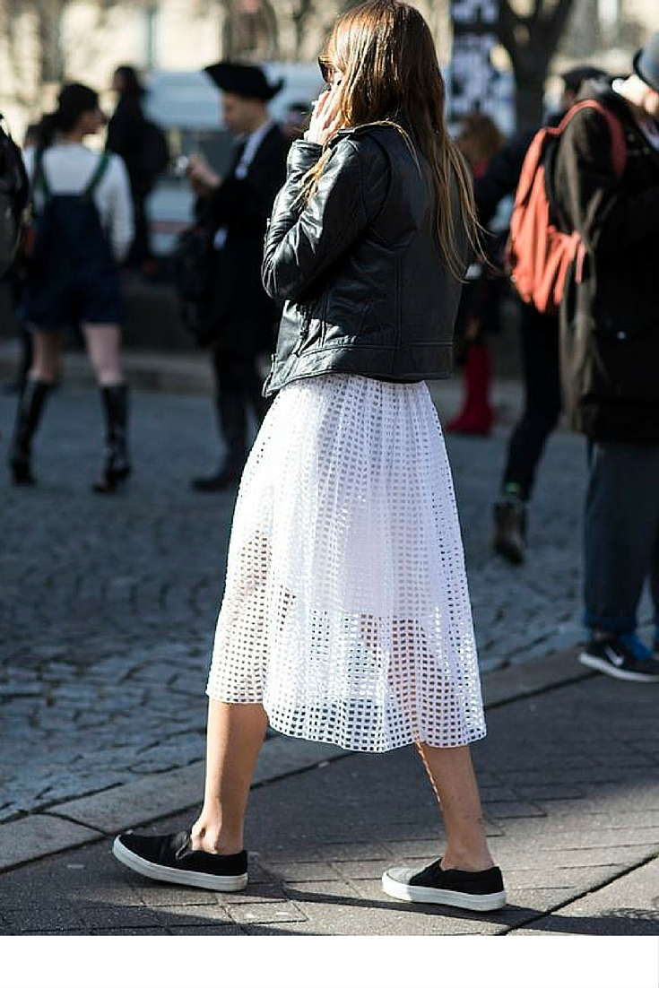 sneakers and pearls, street style, casual look,lwhite lace cut skirt with sneakers and a black leather jacket, trending now.jpg