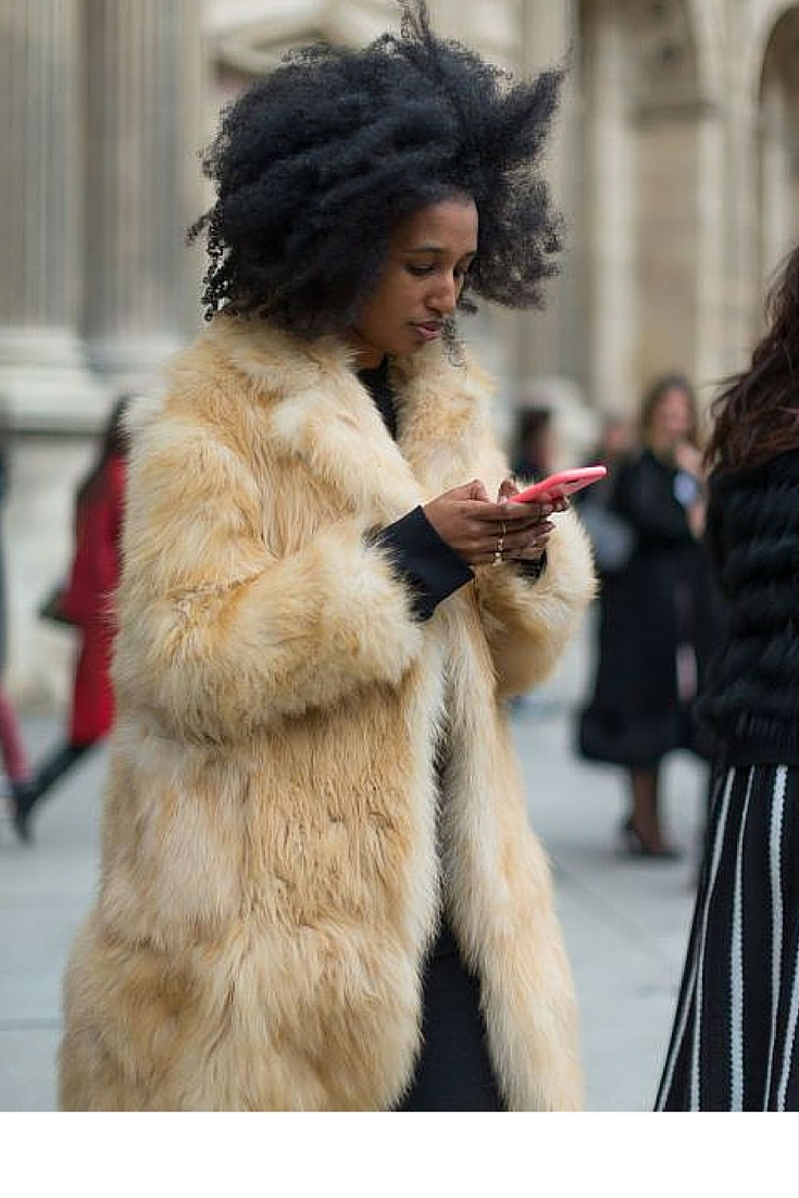 sneakers and pearls, street style, big fur coat with a black ensemble, black suit, trending now.jpg