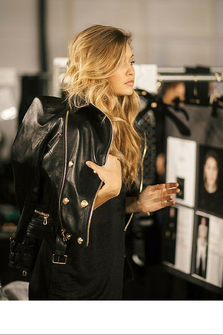 sneakers and pearls, black dress with a black leather jacket for a cool yet sexy look, Gigi hadid is always trending.jpg