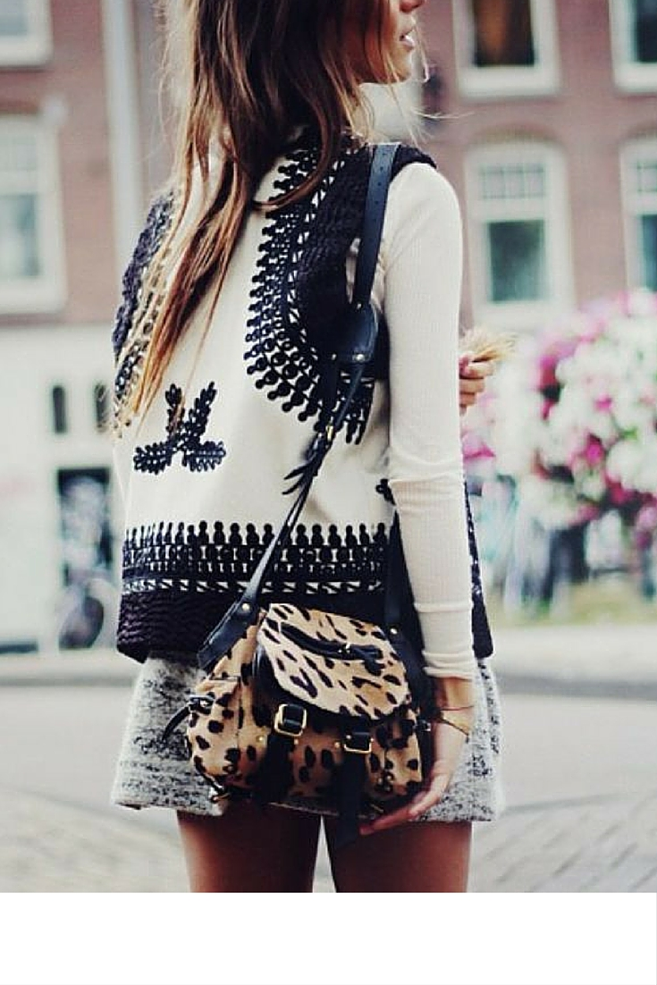 sneakers and pearls, street style, bohemian style, boho vest with a mini dress and an animal print bag, trending now.jpg