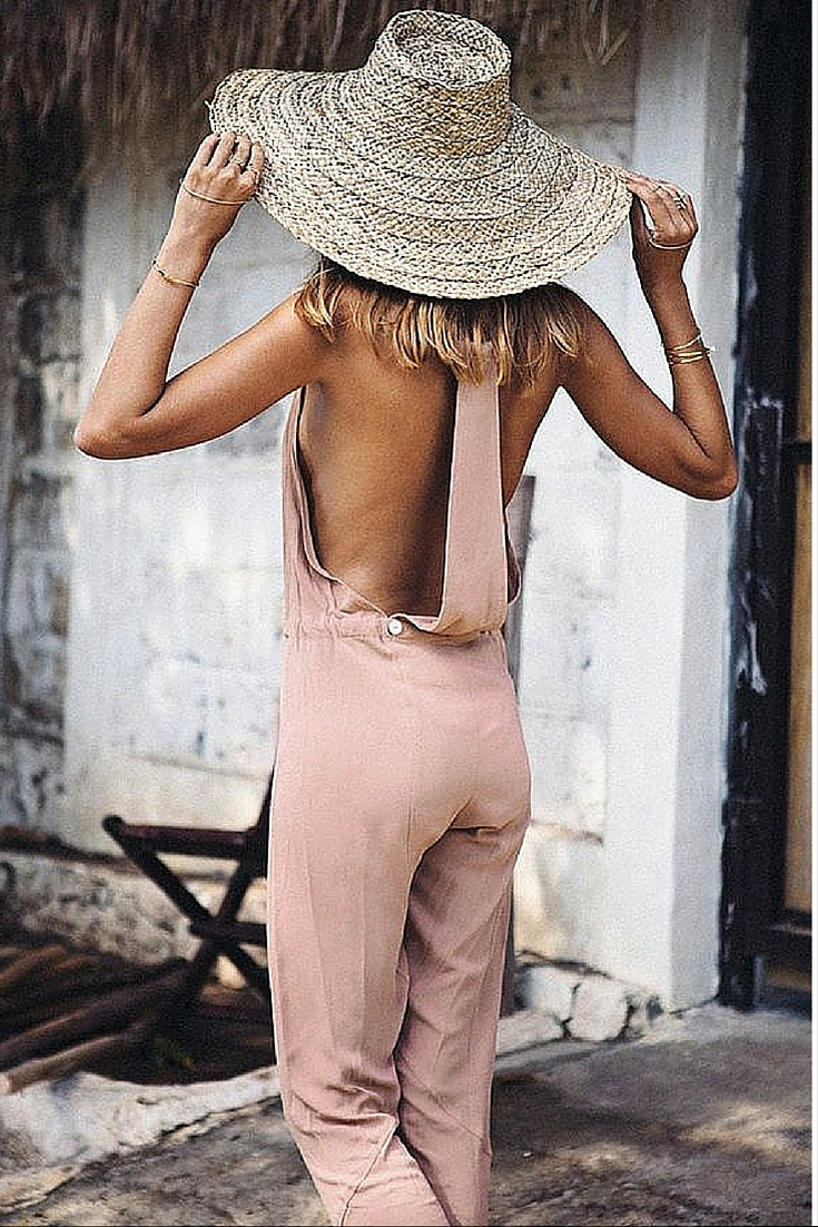 sneakers and pearls, street style,pink jumpsuit with a tan, summer look, trending now.jpg