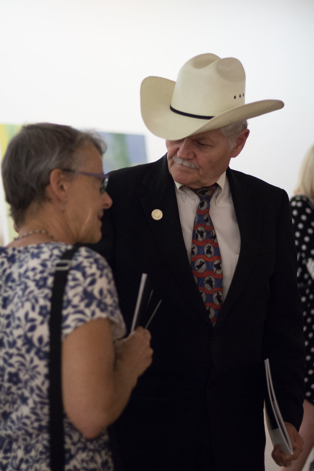 "Ann Graham, executive director of Texans for the Arts (left) and Texas State Representative Charles ""Doc"" Anderson talk in the gallery space of Waco 52."