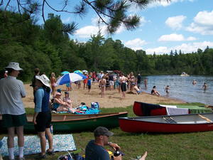 Photo of North Bay Beach during the Paudash Lake Regatta  by  Michelle Annette Tremblay .