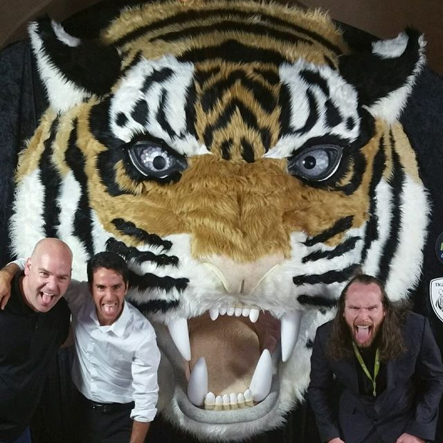 (left to right) John @lucchetti, tiger sculptor Matthew @mcavene & artist @android_jones in front of the tiger heroes work in progress tiger #1 sculpture.