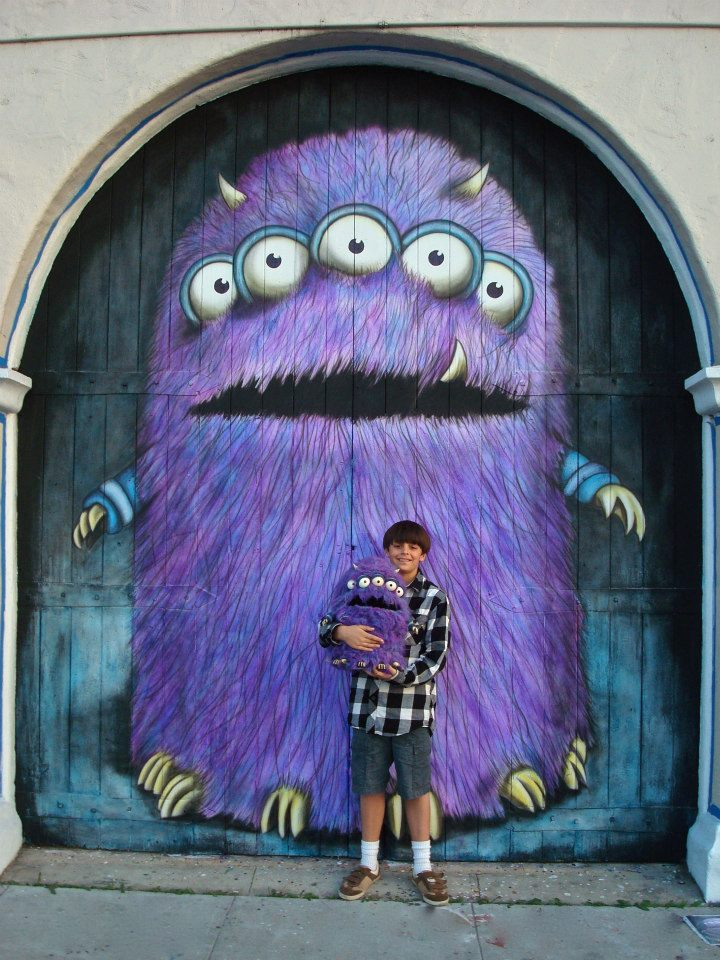 Monster Mural and puppet by Matthew McAvene Ben Catch McAvene in photo holding Monster Puppet.jpg
