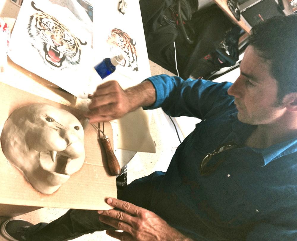 Matthew McAvene Sculpts a tiger head.