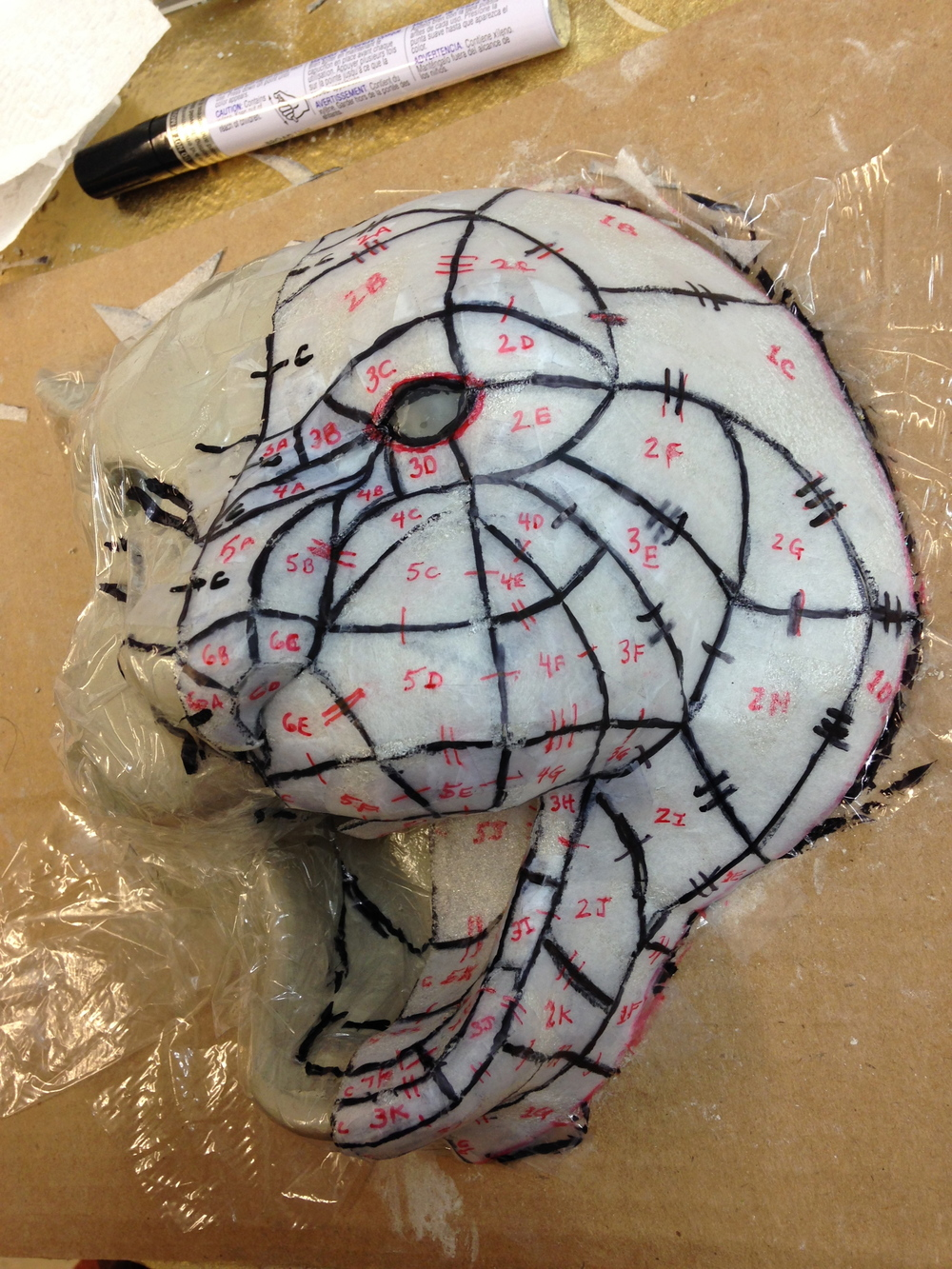 Tiger head patterns on a clay sculpture by Matthew McAvene