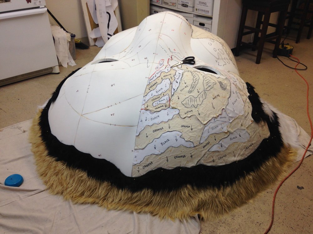 Matthew McAvene covers the tiger head with fur for tiger heroes.jpg