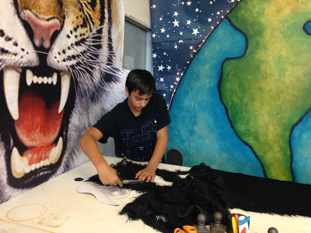 Matthew McAvene's son Ben Catch McAvene cuts fur for the large tiger head sculpture for tiger heroes.jpg