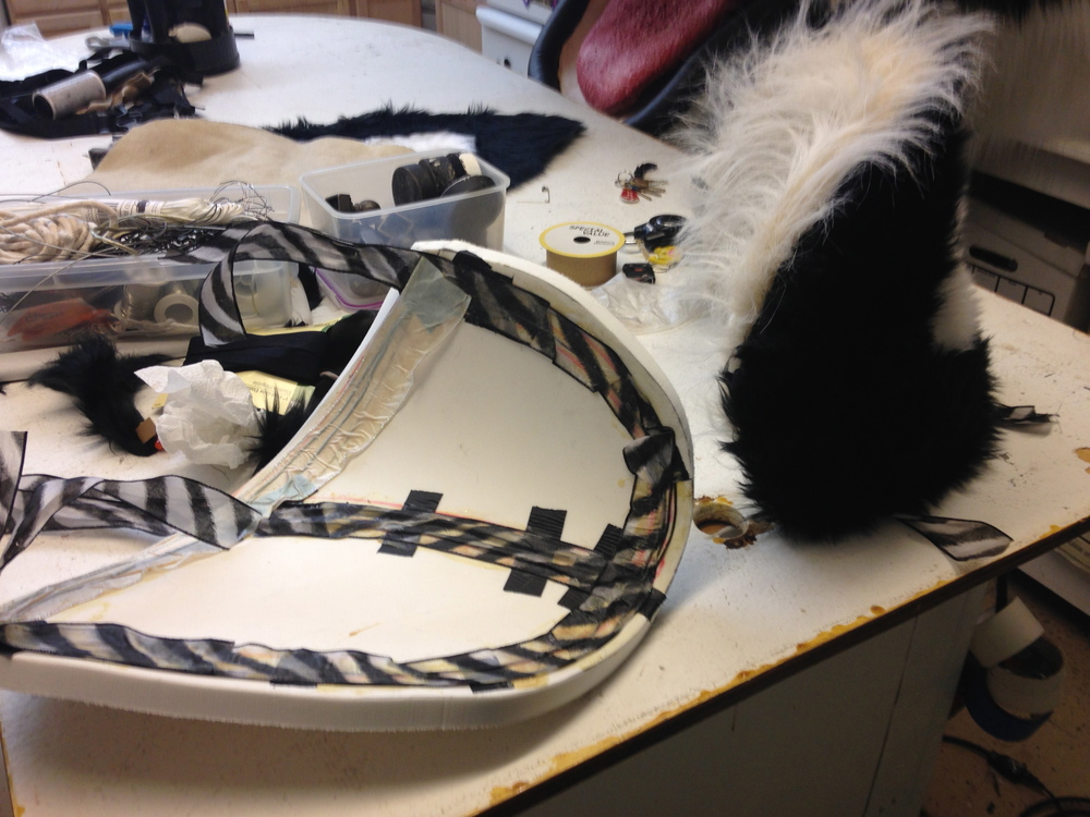 Matthew McAvene creates ears for the large tiger head sculpture.jpg