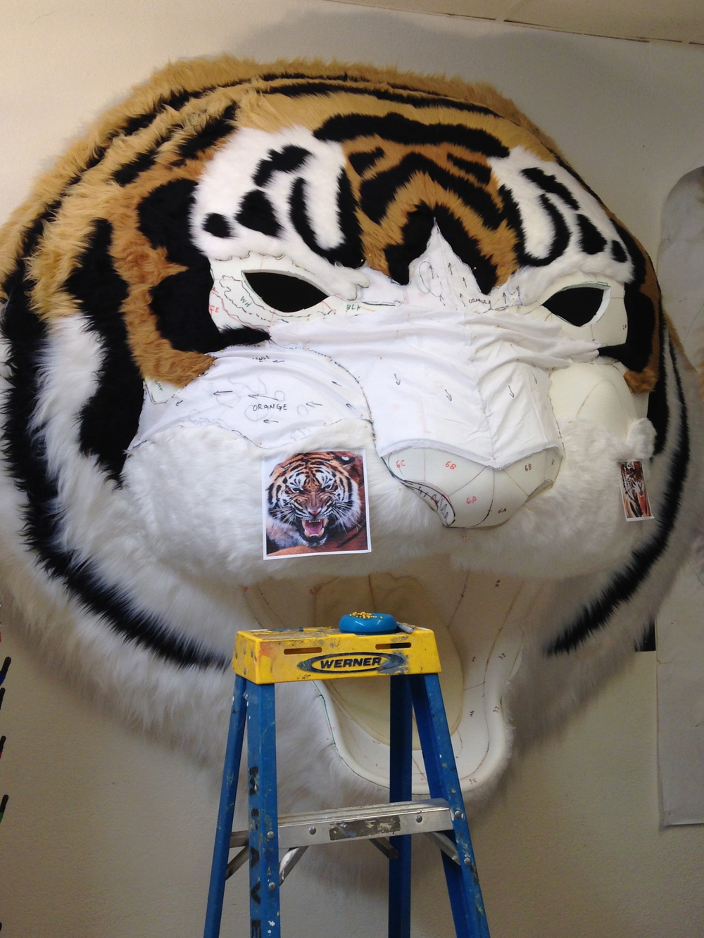 Matthew McAvene Covers the large tiger head sculpture with fur.jpg