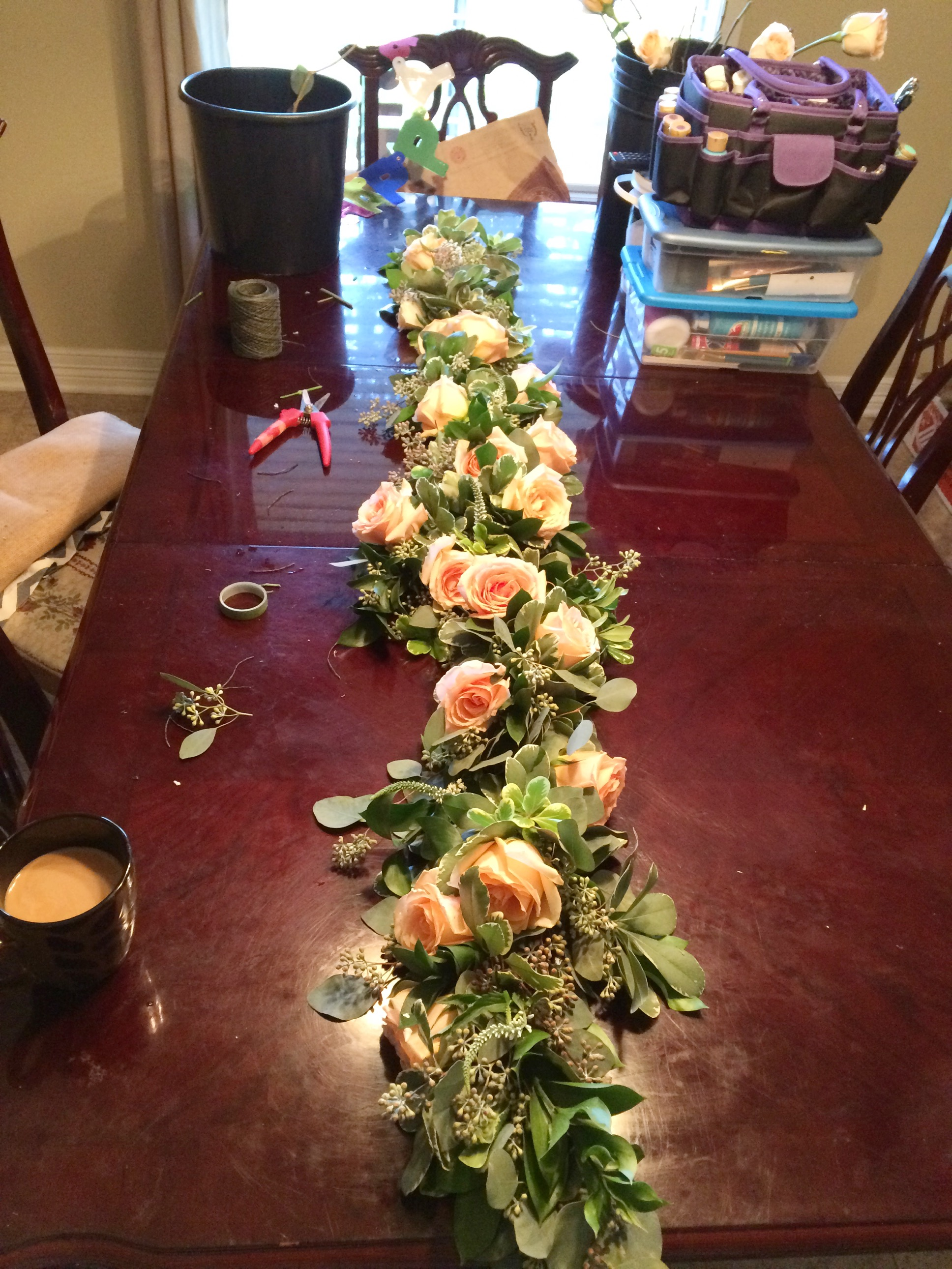 Garland with greens, caramel roses and white veronica