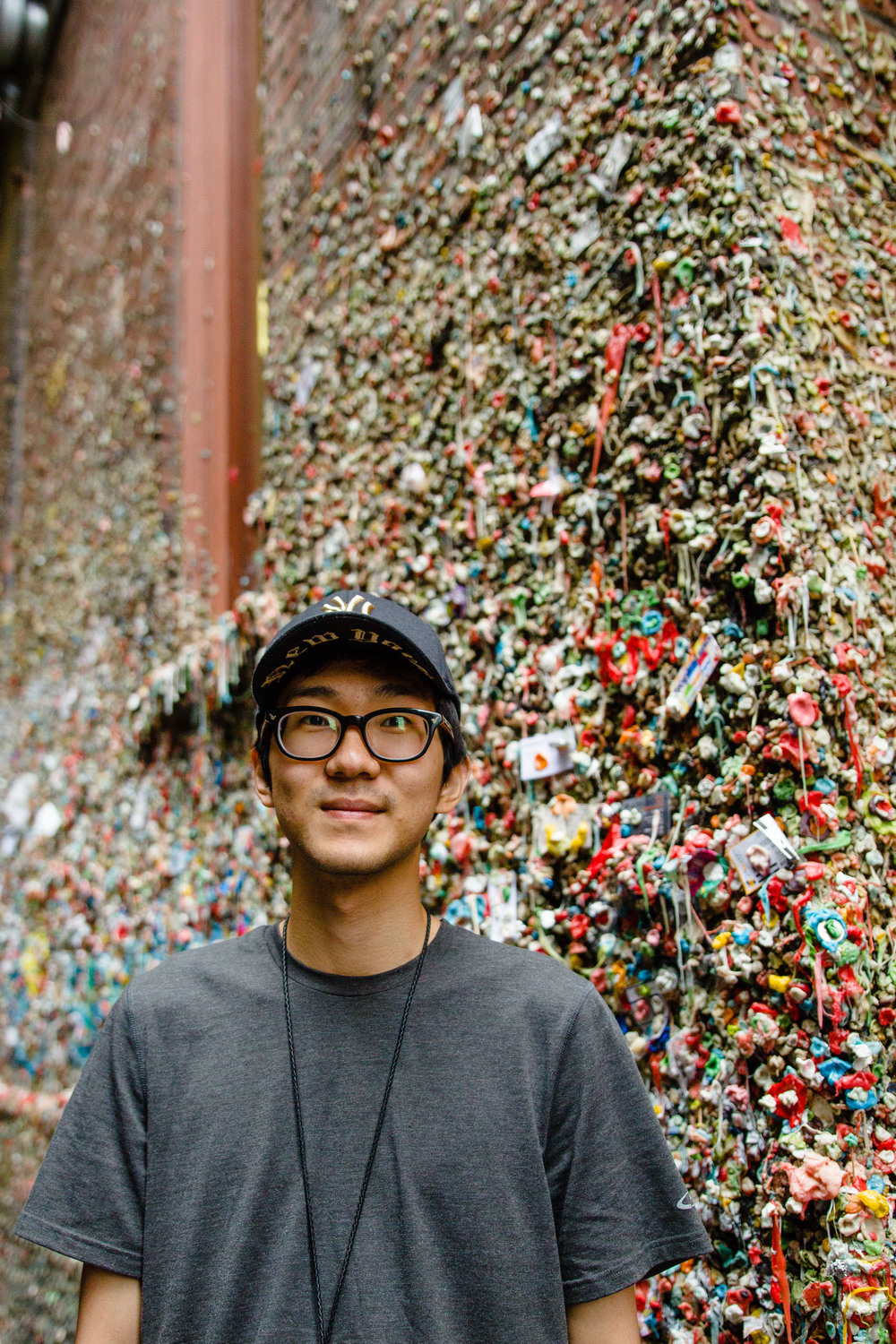 Raymond in front of the Gum Wall (it was kind of gross)