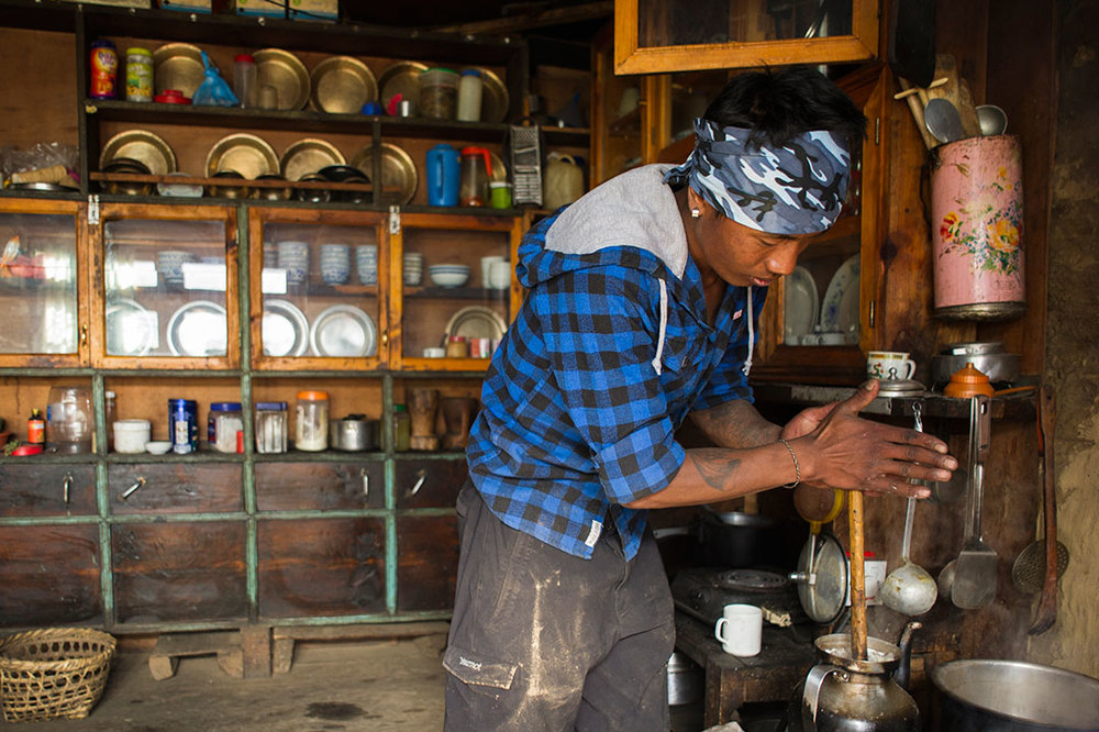 Sonam Sherpa makes Omeecha (milk tea) for the ladies tending his family's fields. The village tends fields as a group.