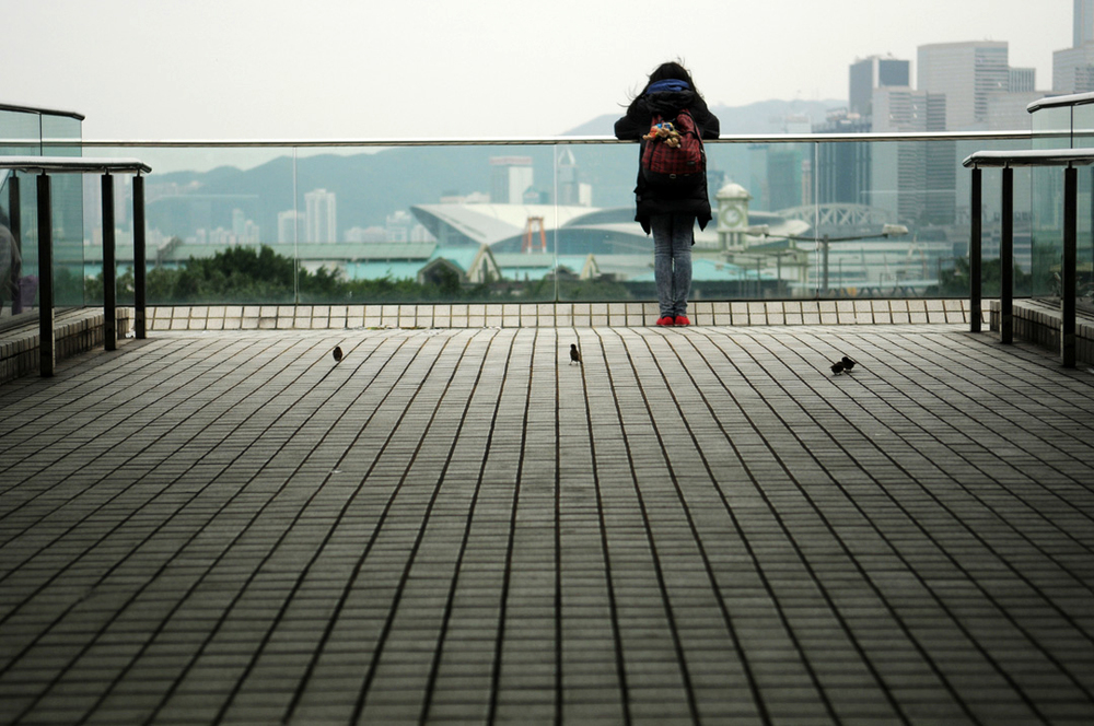 2013- HONG KONG- A girl waits for the Discovery Bay ferry at the terminal in Hong Kong.