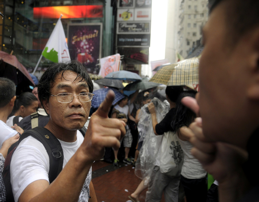 2014- HONG KONG- A protester argues with a police officer during a protest on Establishment Day. Protesters called for Beijing to honour its promise of full-democracy in Hong Kong.