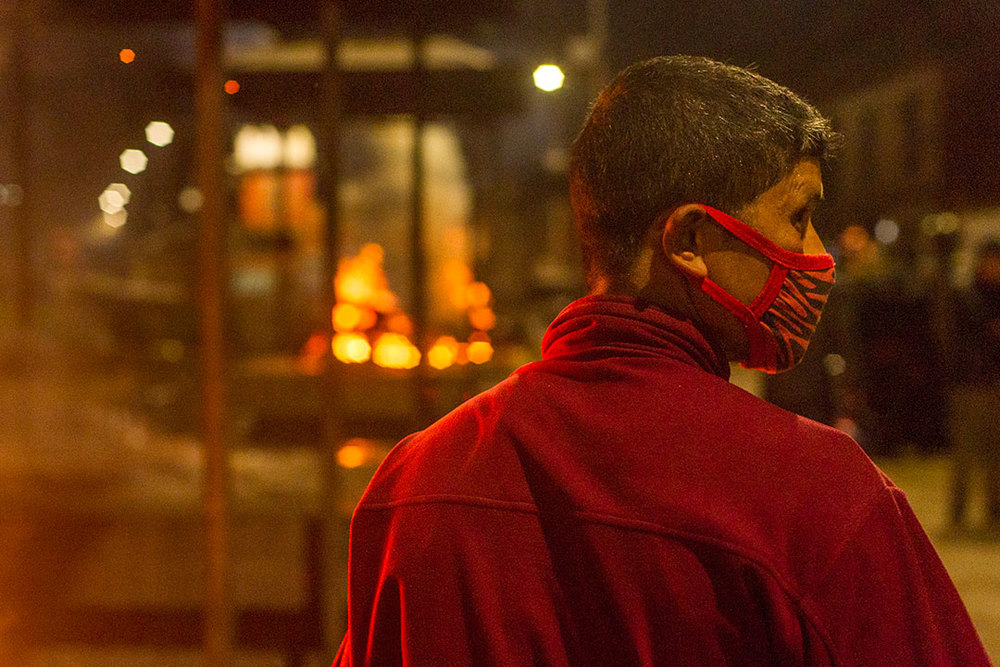 APRIL 20- KATHMANDU-A cremator takes a breath of fresh air during a cremation at Pashupati temple.