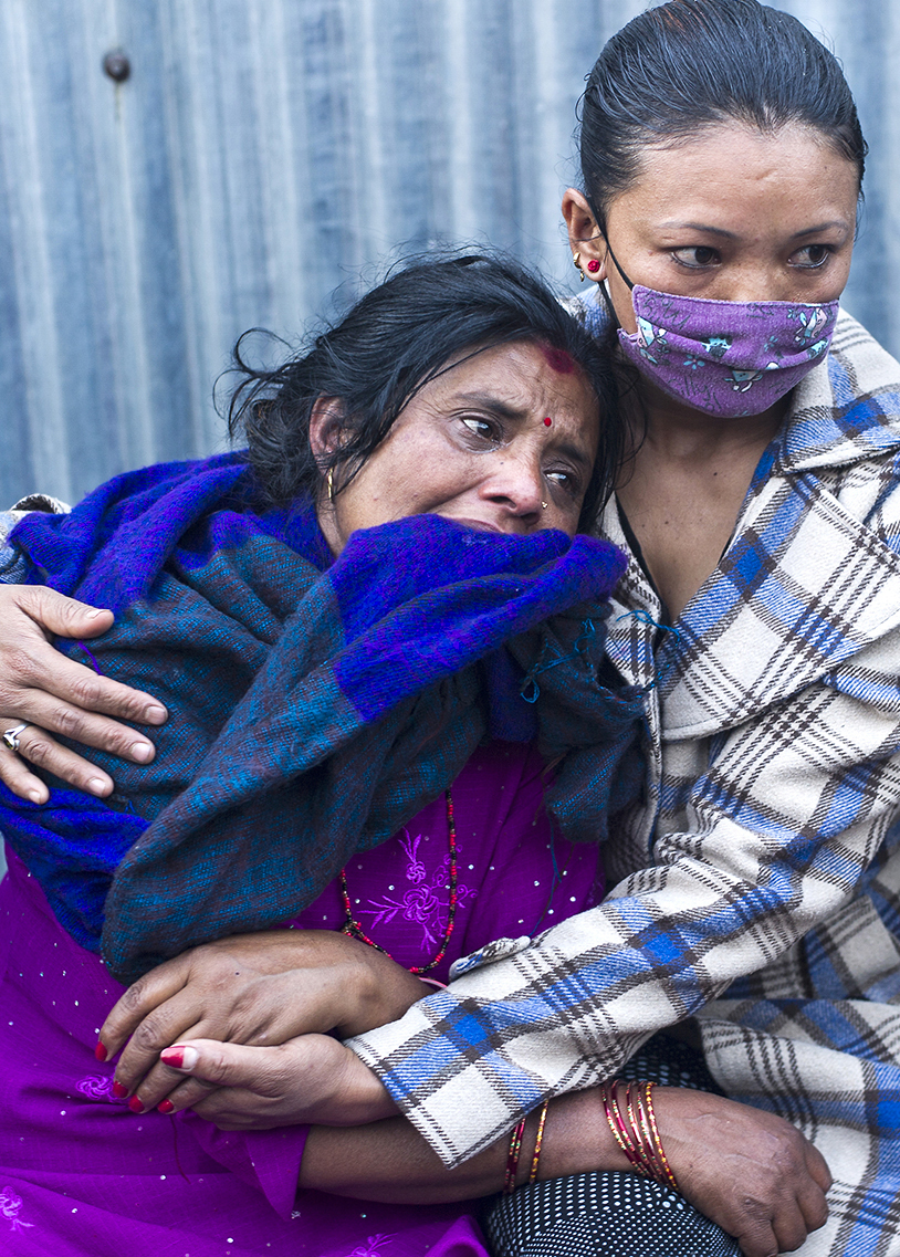 A mother cries as she watches the cremation of her child at Pashupati temple in Kathmandu days after the earthquake.