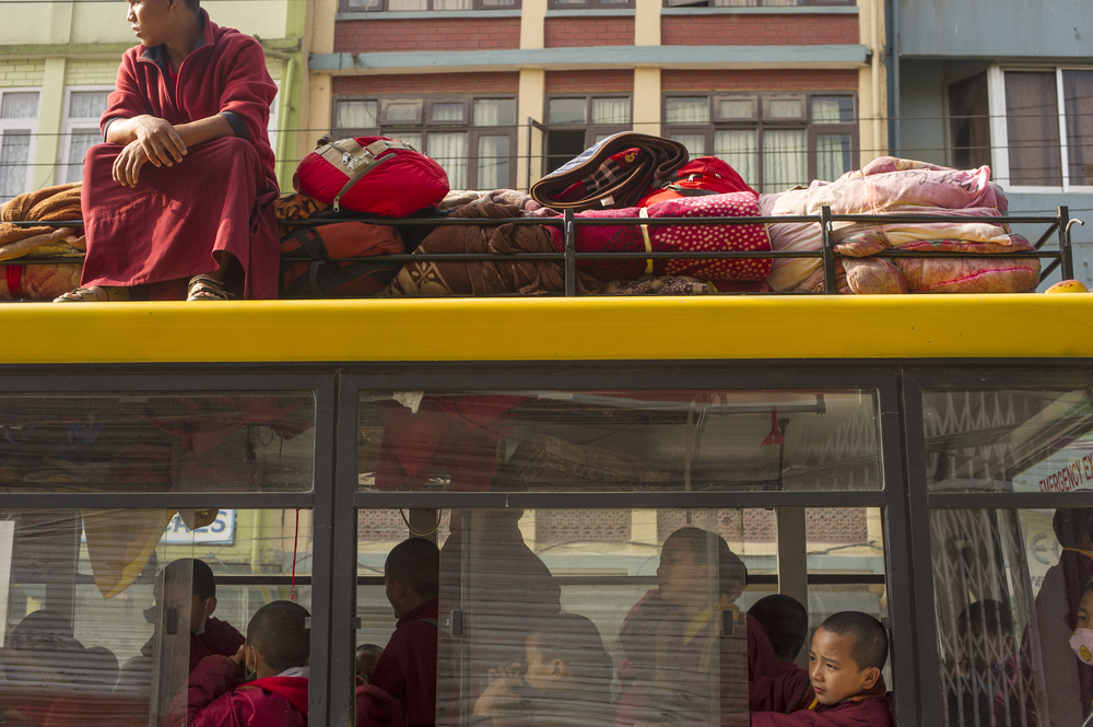 A group of young monks wait for traffic on their way to Boudhanath Stupa in Kathmandu.