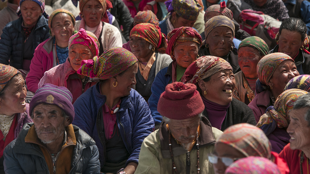 Villagers from Thame and surrounding villages wait for their turn to collect food donations from Kopan Monastery.