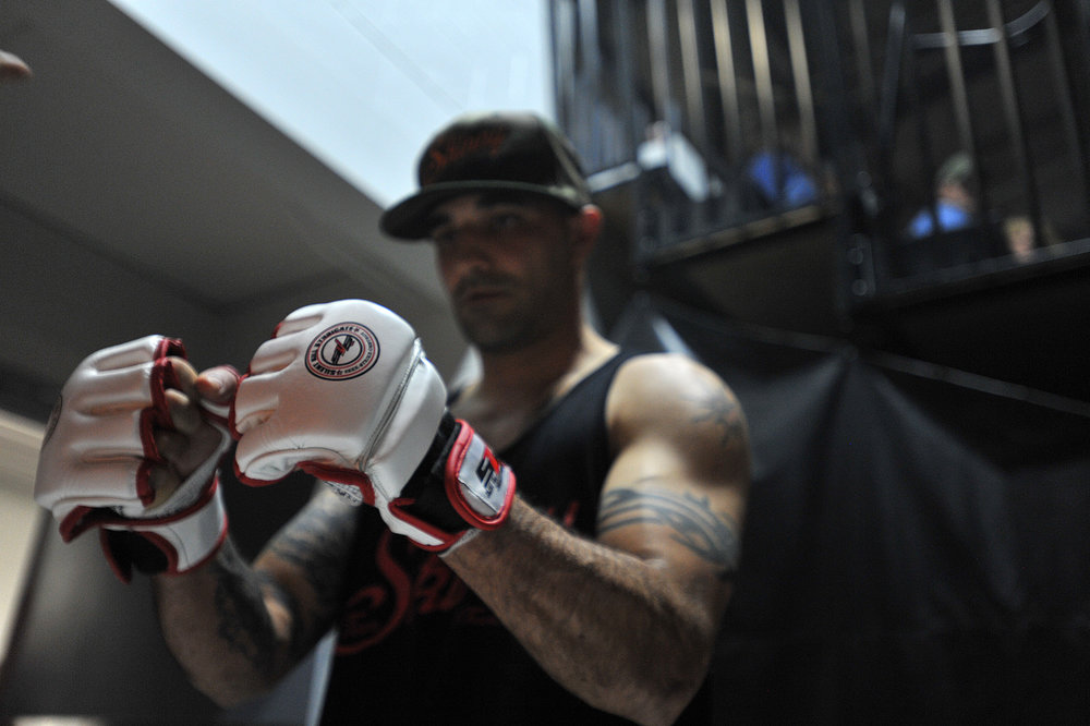 Mark Murray gets his gloves taped before his fight at the Can-Am MMA Championship in Watertown.