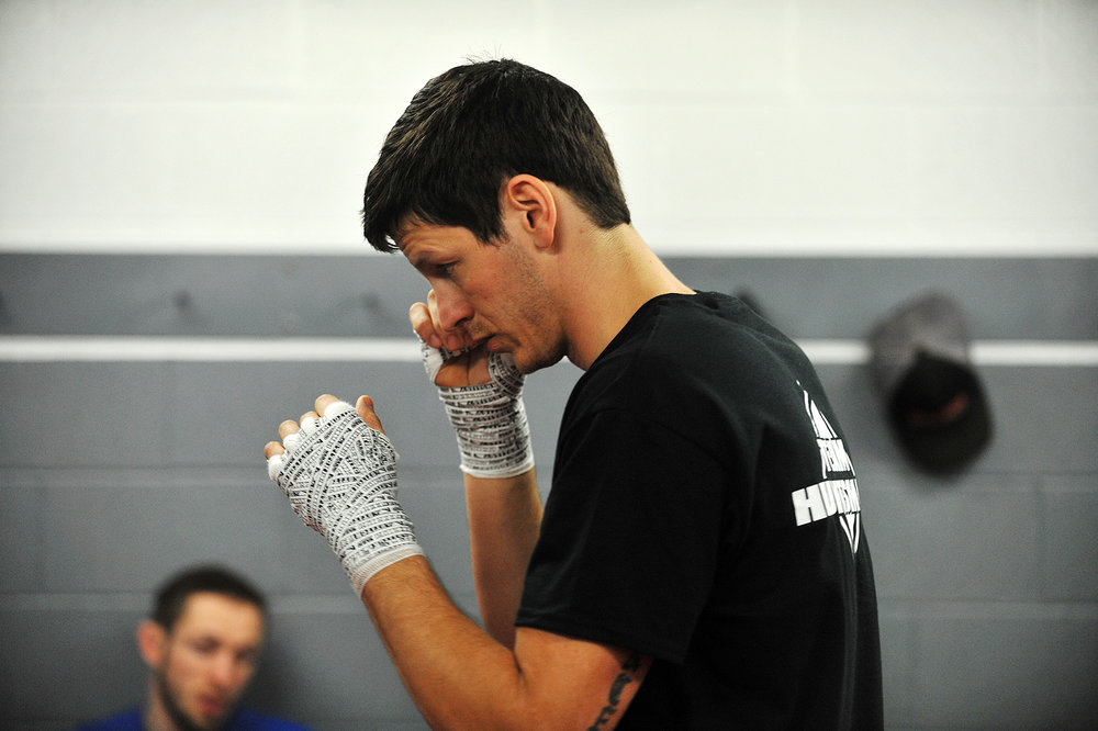 Rick Huntsman warms up in the locker room before his fight during the Can-Am MMA Championship in Watertown.