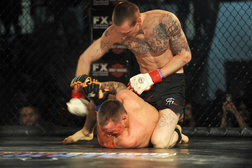 Dylan Snyder tries to fend off punches from Brantley Churchill. This was the first fight for both Snyder and Churchill.