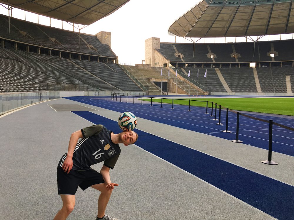 Kitted out in the Germany National Team kit right next to the iconic blue running track.
