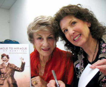 Nika Fleissig (left), mother of Rabbi Alicia Magal (right), signing copies of the book the Rabbi wrote about her mother's dramatic story of survival during the Holocaust.
