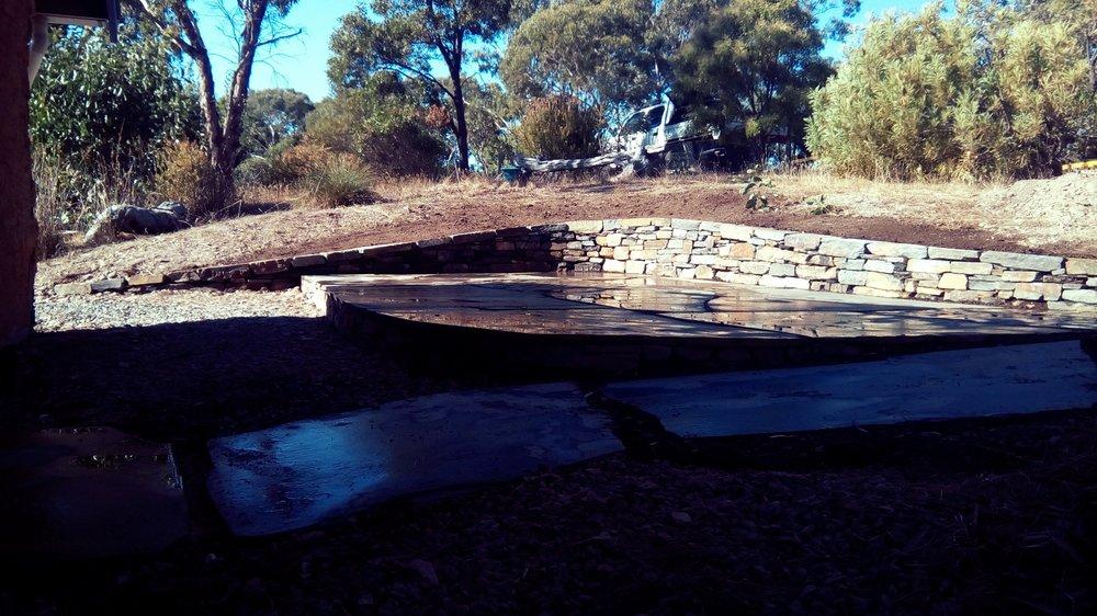 Dry Stone Retaining Wall & Slate Paving. Coromandel East, South Australia.