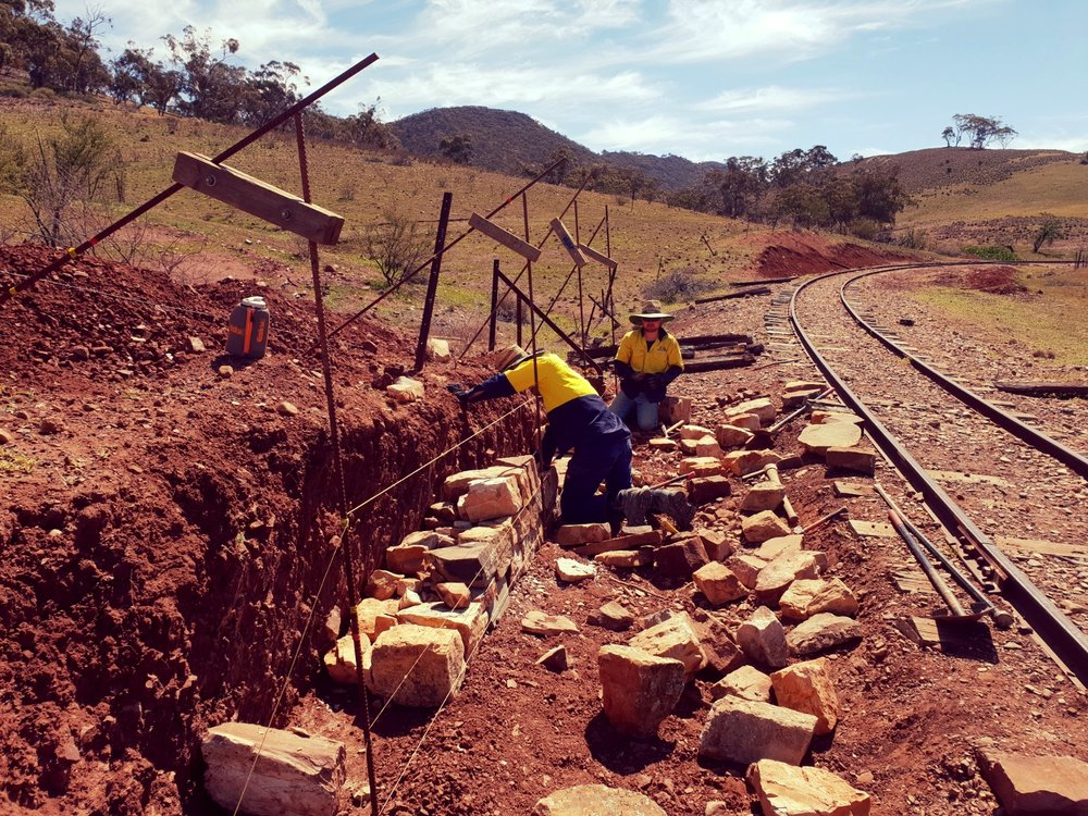 Rebuilding an historic dry stone retaining wall on the Pichi Richi Railway. Quorn, South Australia