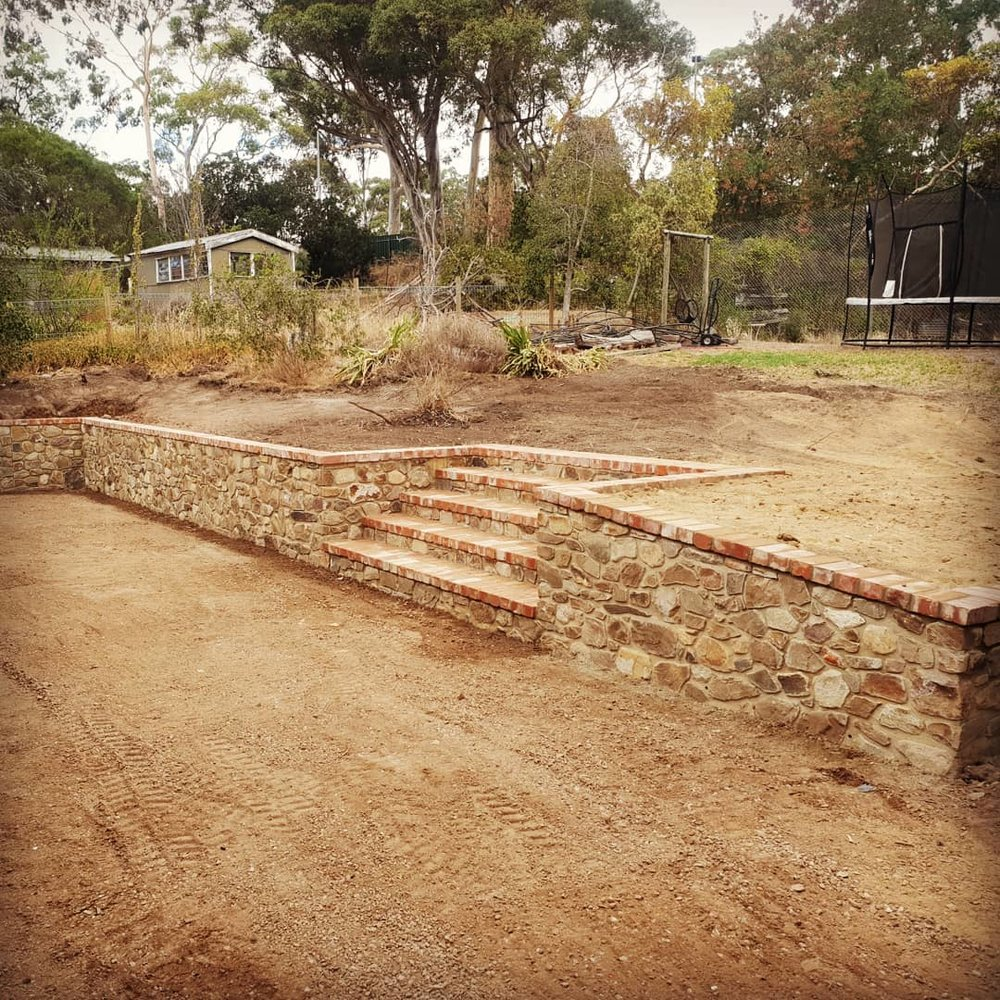 Site Sourced Stone Retaining Walls with Recycled Brick Capping. Hawthorndene, South Australia