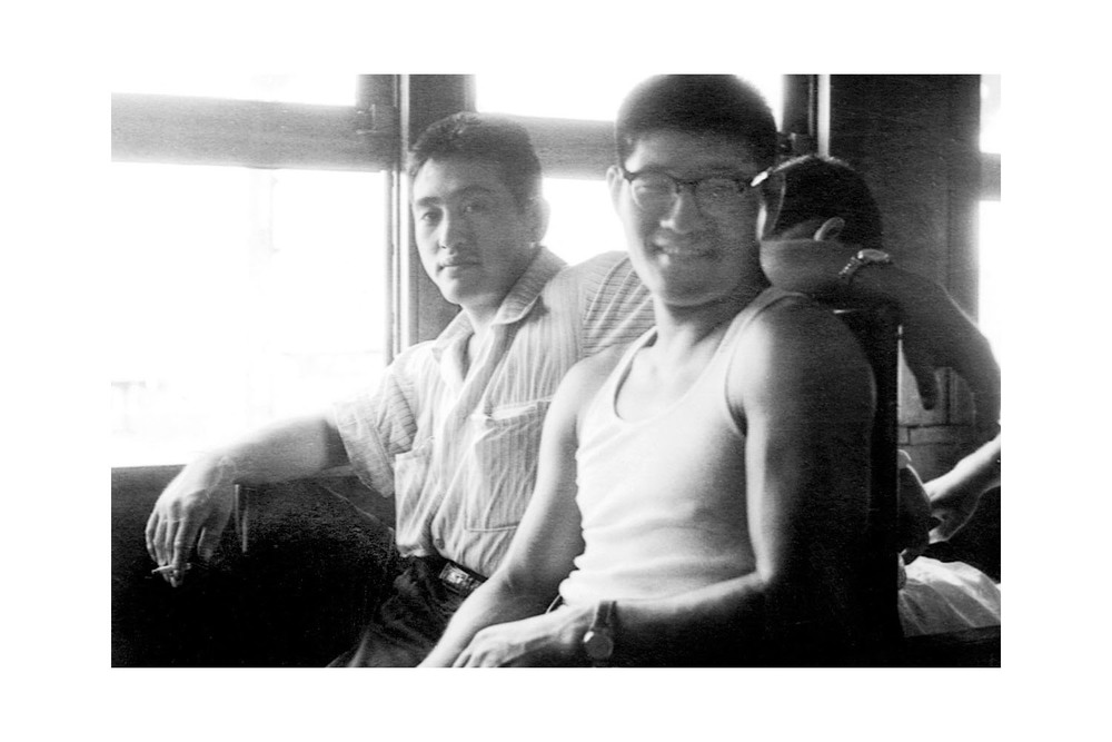 Akinori Hosaka and Yoshisada Yonezuka, travelling to a Judo contest on a train. Copyright unknown.