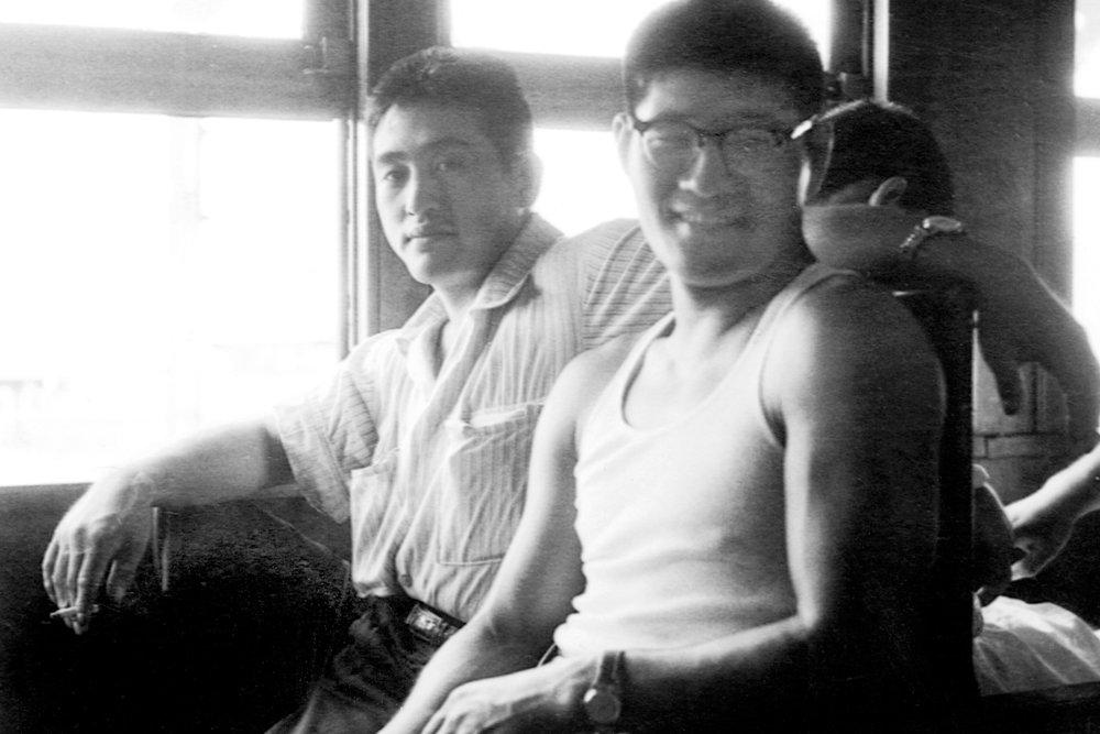 Akinori Hosaka (left) and Yoshisada Yonezuka, on a train travelling to a Judo competition, c.1960