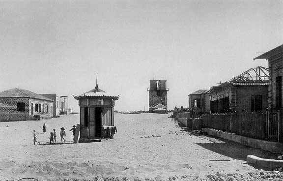 The first water tower in Tel Aviv(depictsTel Aviv as sparse and empty, and demonstrating the 'modern successes' of early Zionist settlers). Photo byAvraham Soskin.