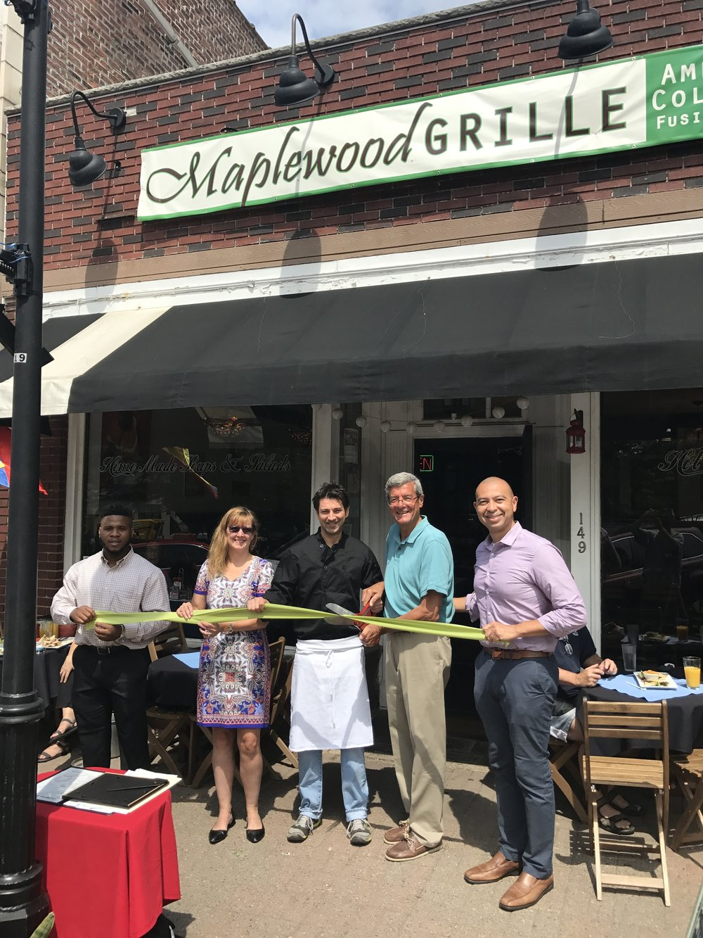 Left to right -- Uche Uneze (Maplewood Green Business intern), Sheila Baker Gujral (Maplewood Environmental Advisory Committee), Andres Ulloa (Maplewood Grille), Mayor Vic DeLuca, and Township Committeeman Frank McGehee