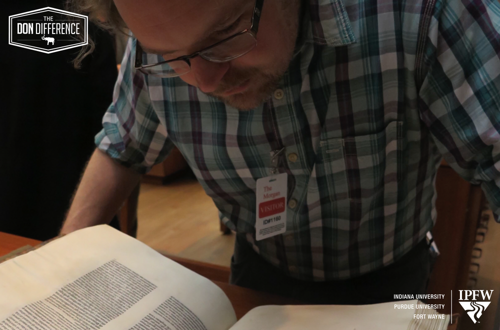 As part of his research, Professor Fleming studies ancient tomes firsthand.