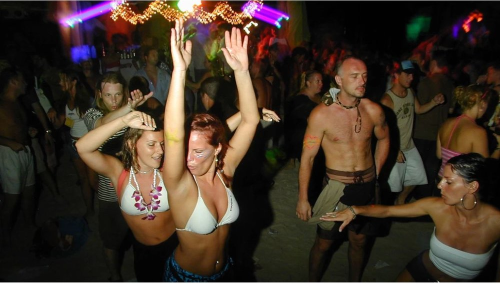 Revellers at a full moon party on Koh Phangan, Thailand. Photo: Dan Vincent / Alamy Stock Photo