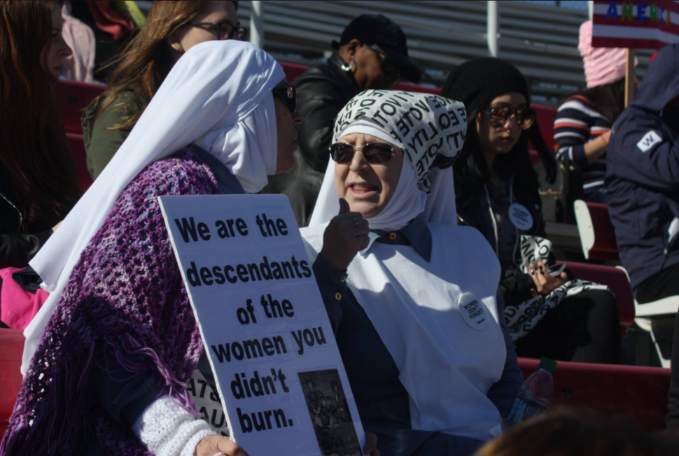 The sisters attend a 2018 women's march in California.