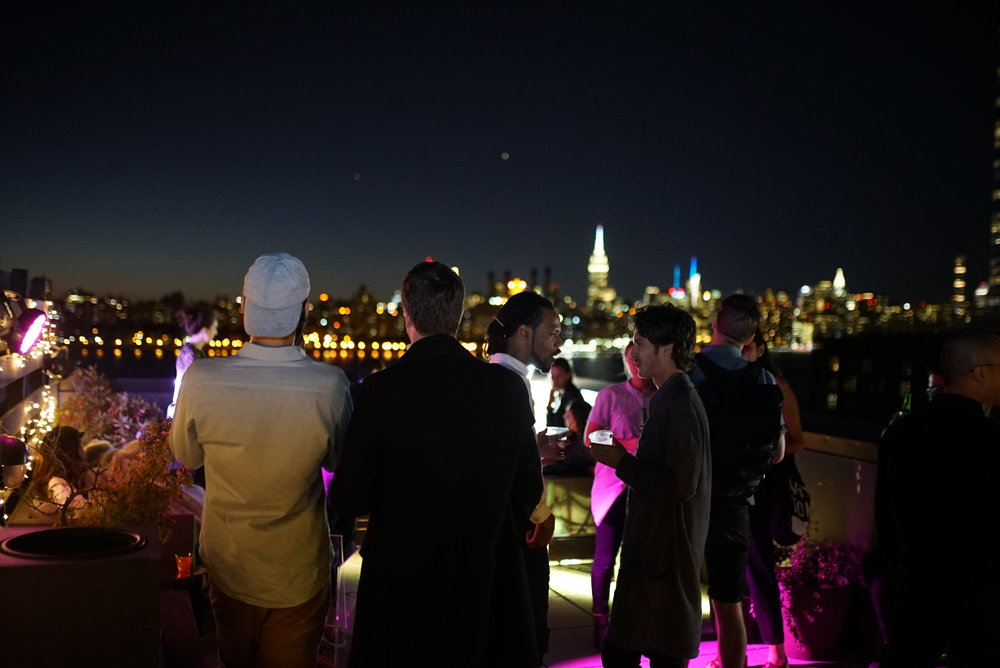 Guests enjoying rooftop views.