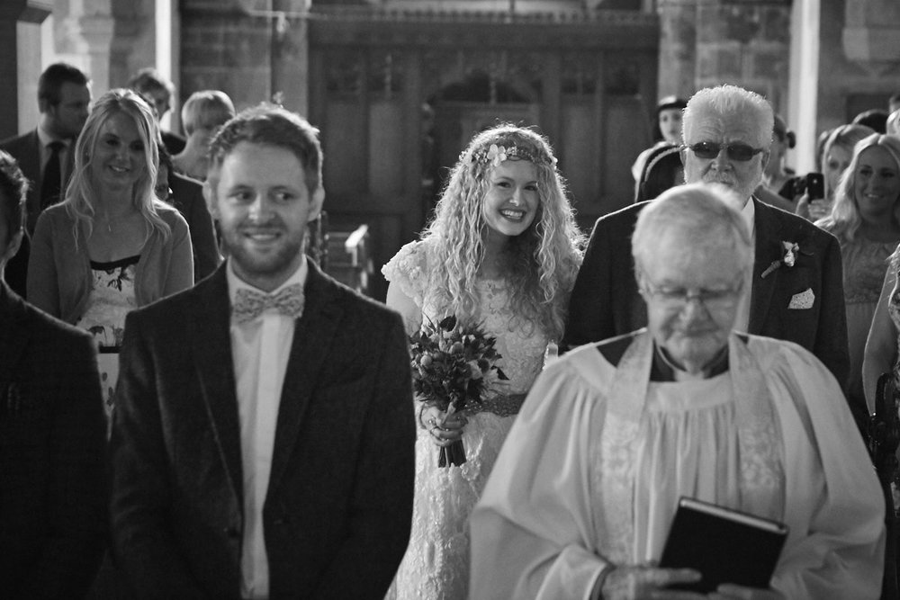 A bride walks to the alter in a Lincolnshire wedding