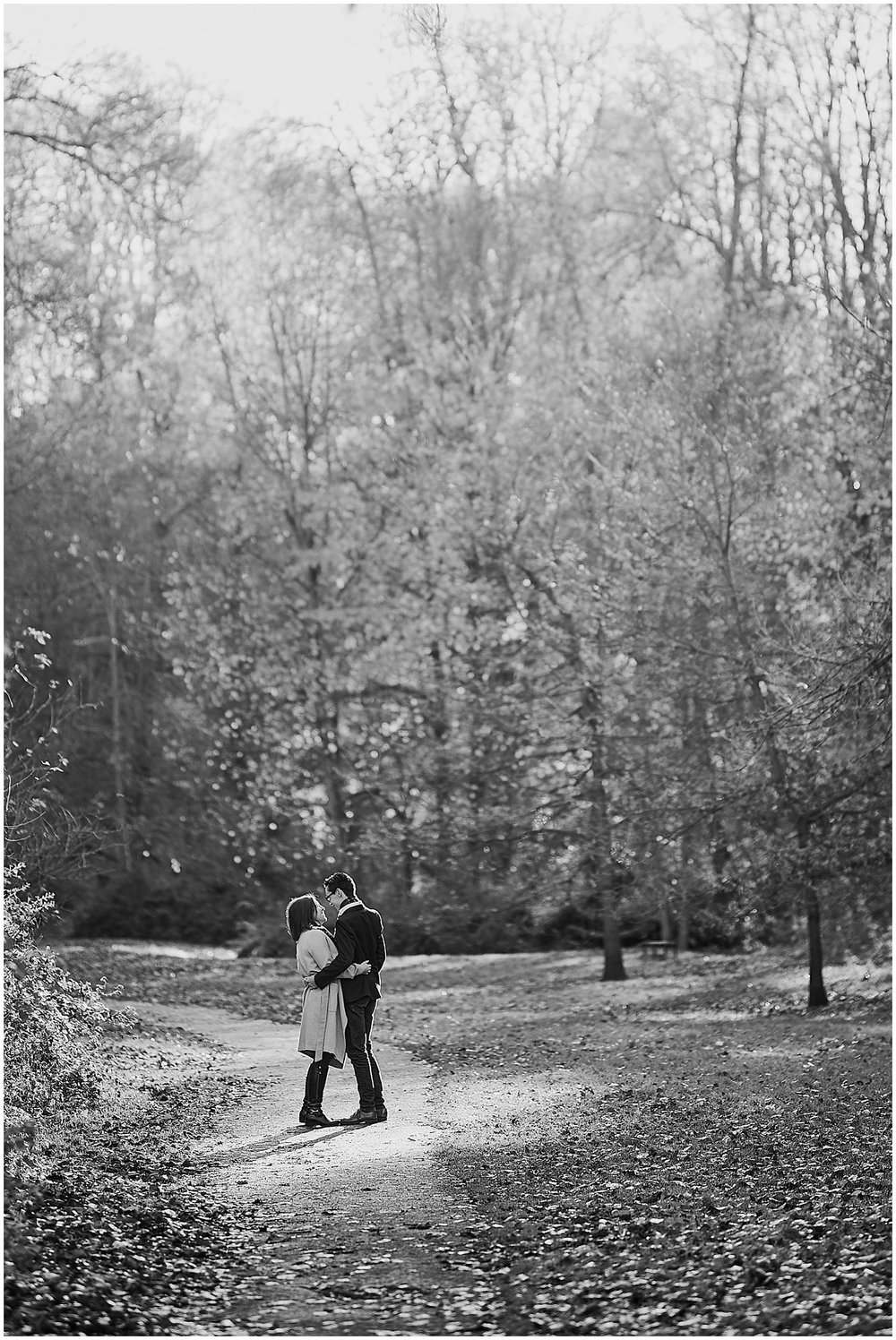 A couple sharing a moment of love during their engagement photoshoot in beautiful winter light at Hubbards Hills, Louth, Lincolnshire