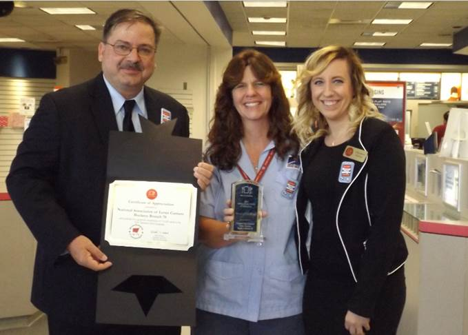Stephanie presented the NALC with the Award of Excellence for the amount of food collected at last year's food drive (approx.. double from the previous year).    NALC Branch 78 President Todd Hornyak; City Letter Carrier Jackie Mitchell (Gahanna) and Food Drive Coordinator; Stephanie Warner with Mid-Ohio Food Bank
