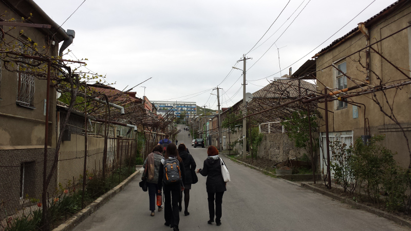 That's my cluster walking to lunch. More importantly, you see those vines crawling up on the sides? Those are grape vines and they grown in front of nearly every home here in Gori. Just about everyone makes their own wine! Can't wait to see them fully verdant.