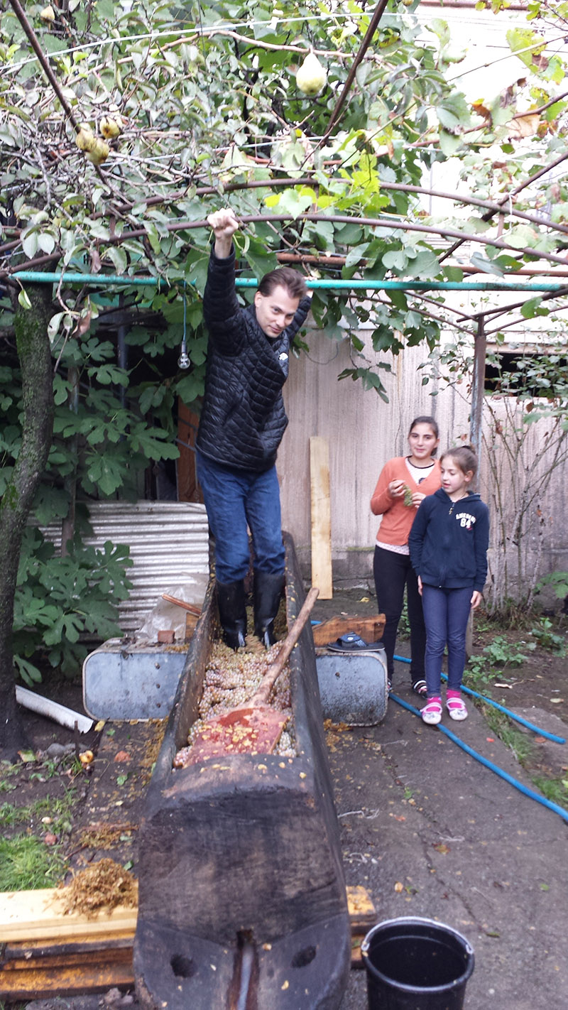 Holding onto the trellis for dear life while my cousins look on dubiously.