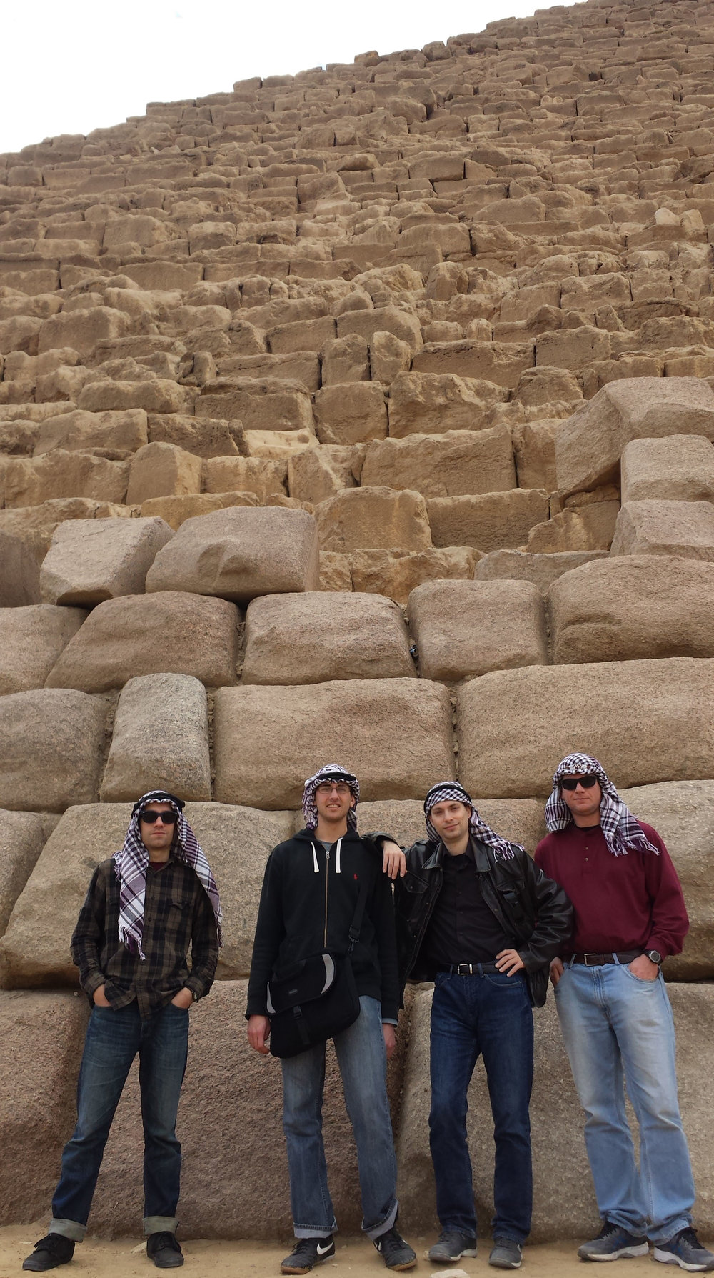 The crew posing in front of Menkaure's pyramid. From left to right: Tyler, Stanley, BJ, and Dan.