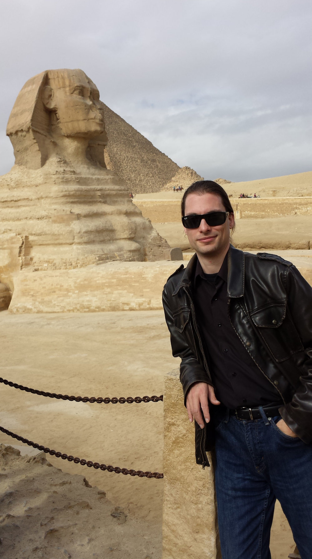 Some smug fool posing with the sphinx.