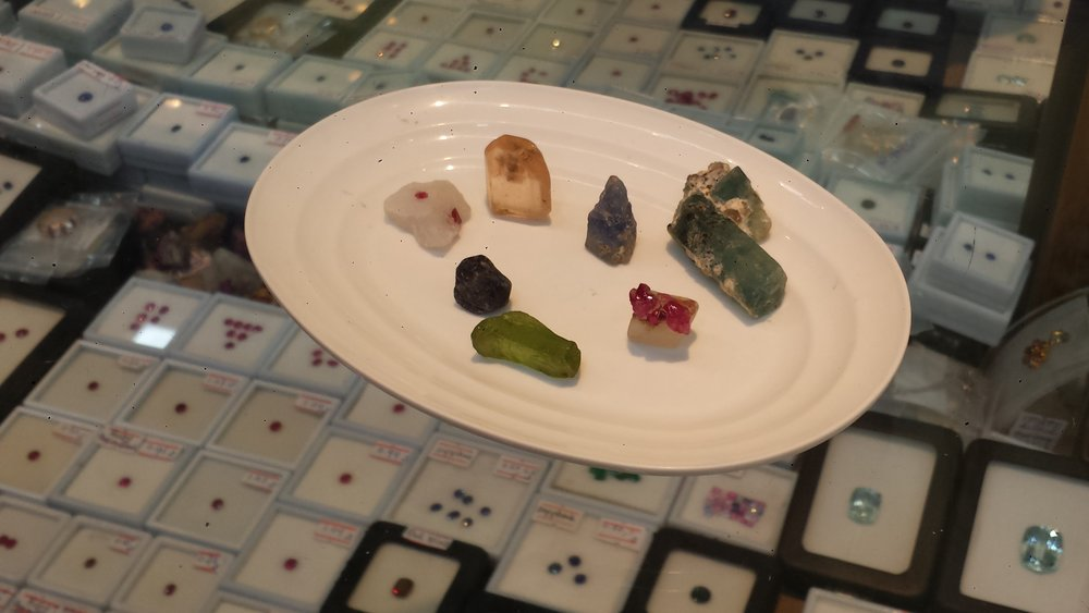 Left to right: spinal, topaz, sapphire, peridot, sapphire, aquamarine, and ruby